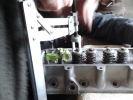 engine head 05 compressing the valve spring 2